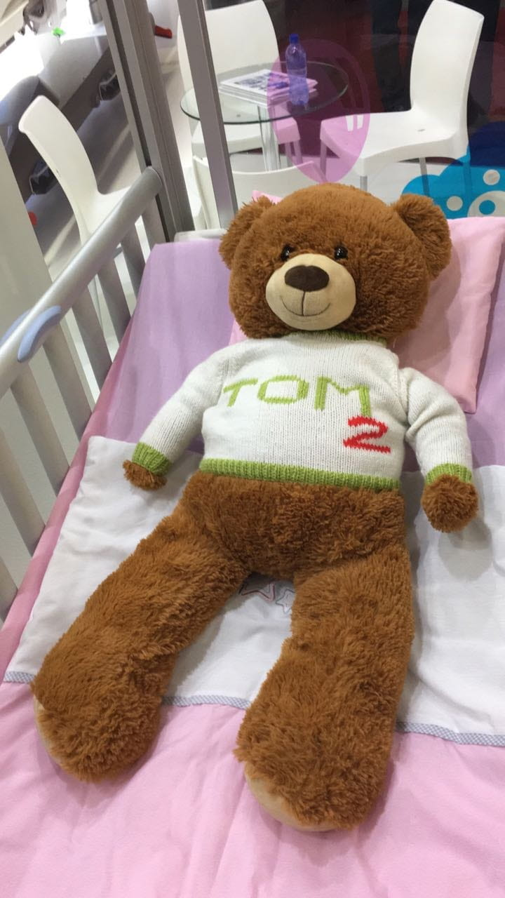 LINET at Africa Health - paediatric bed TOM2 with our little patient teddy bear
